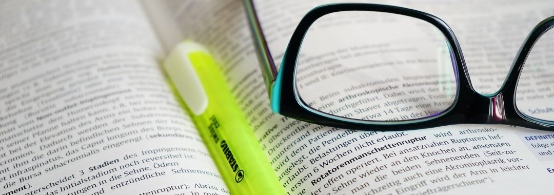Glasses and Reading Book